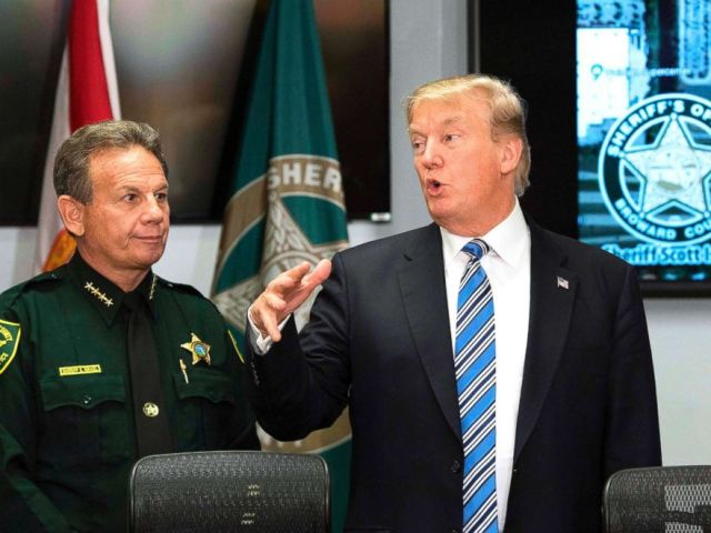 PHOTO: President Donald Trump speaks with Broward County Sheriff Scott Israel while visiting first responders at Broward County Sheriffs Office in Pompano Beach, Fla., on Feb. 16, 2018.