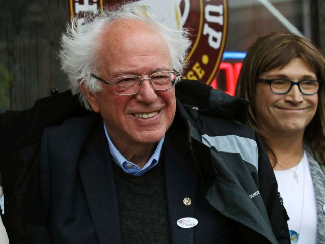 PHOTO: Sen. Bernie Sanders smiles as he poses for a photograph with Vermont Democratic gubernatorial candidate Christine Hallquist outside City Hall in Saint Albans, Vt., Nov. 6, 2018.