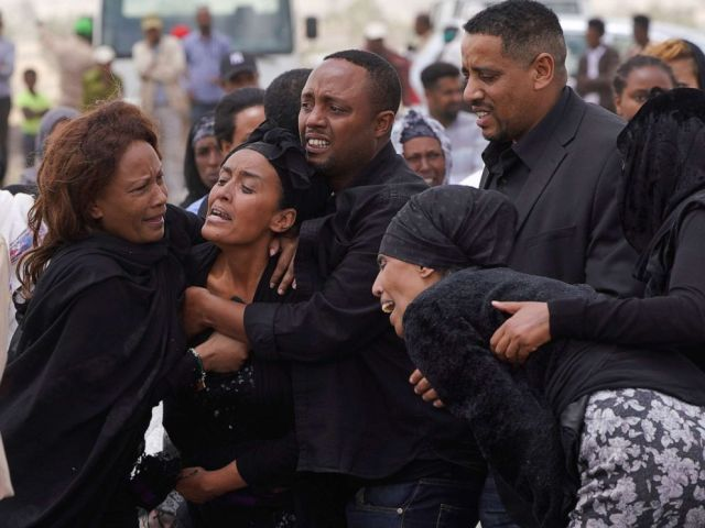 PHOTO: Mourners visit the crash site of Ethiopian Airlines Flight ET302 on March 14, 2019, in Ejere, Ethiopia.