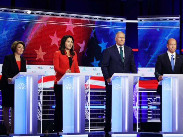 PHOTO: Sen. Amy Klobuchar (D-MN), Rep. Tulsi Gabbard (D-HI), Washington Gov. Jay Inslee and former Maryland congressman John Delaney take part in the first night of the Democratic presidential debate on June 26, 2019 in Miami, Florida.