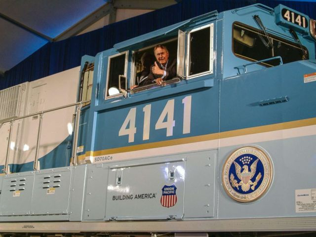 PHOTO: Former President George H.W. Bush gives a thumbs-up from the cab of Union Pacific Locomotive No. 4141 at its unveiling in 2005.