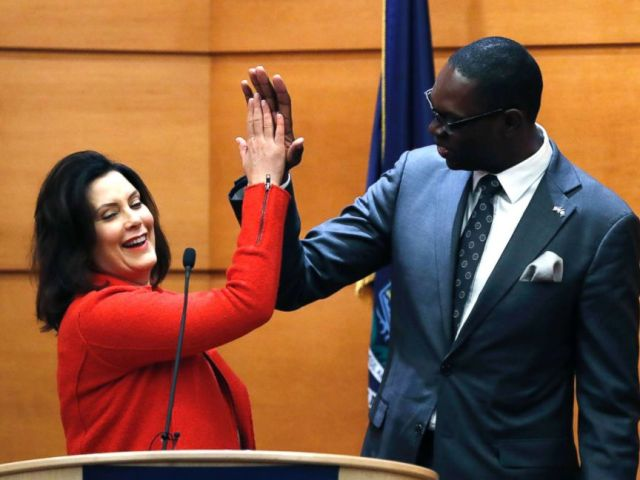PHOTO: Michigan Gov.-elect Gretchen Whitmer high-fives Lt. Gov.-elect Garlin Gilchrist II during their post-election news conference in Detroit, Nov. 7, 2018.