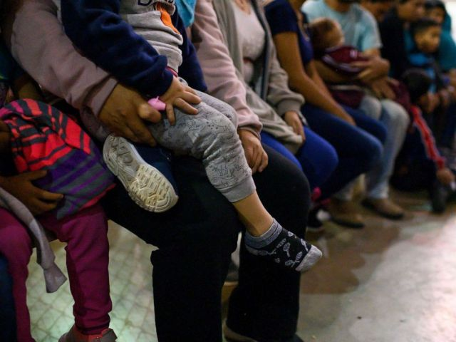 PHOTO: Recently detained migrants, many of them family units, sit and await processing in the US Border Patrol Central Processing Center in McAllen, Texas on August 12, 2019.