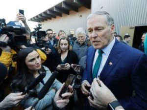 PHOTO: Washington Governor Jay Inslee answers questions from reporters after speaking at a campaign event in Seattle, March 1, 2019.
