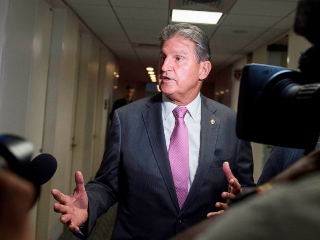 PHOTO: U.S. Senator Joe Manchin speaks with reporters in the Senate Hart building as a rally against Supreme Court nominee Brett Kavanaugh takes place on Capitol Hill in Washington, D.C., Oct. 4, 2018.