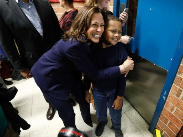 PHOTO: Sen. Kamala Harris, D-Calif., hugs eight-year-old Manaath Kai, of Des Moines, Iowa, after a get out the vote rally, Oct. 22, 2018, at Des Moines Area Community College in Ankeny, Iowa.