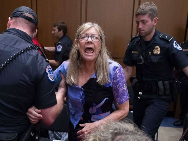 PHOTO: A woman is removed from the hearing by police as she shouts in protest against judge Brett Kavanaugh during the Senate Judiciary Committes confirmation hearing on his nomination in Washington, Sept. 5, 2018.