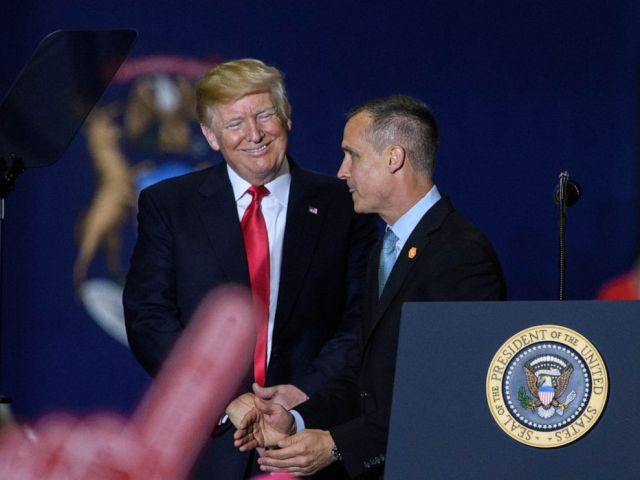PHOTO: Former Trump Campaign manager Corey Lewandowski speaks as US President Donald Trump looks on during a rally at Total Sports Park in Washington, Michigan on April 28, 2018.