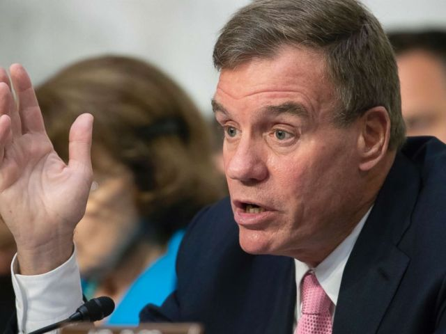 PHOTO: Sen. Mark Warner asks questions during a hearing on Capitol Hill in Washington, D.C., July 25, 2018.