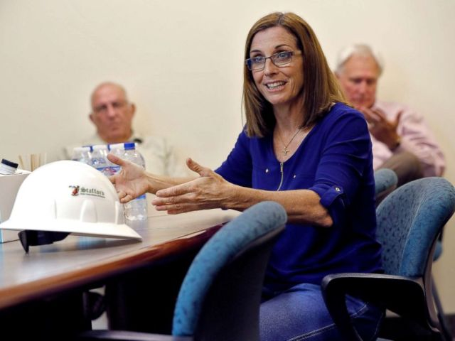 PHOTO: U.S. Rep. Martha McSally, who is running against U.S. Rep. Kyrsten Sinema, for the senate seat being vacated by retiring U.S. Sen. Jeff Flake, talks to employees at a crane manufacturing and training facility, in Phoenix, Oct. 3, 2018.