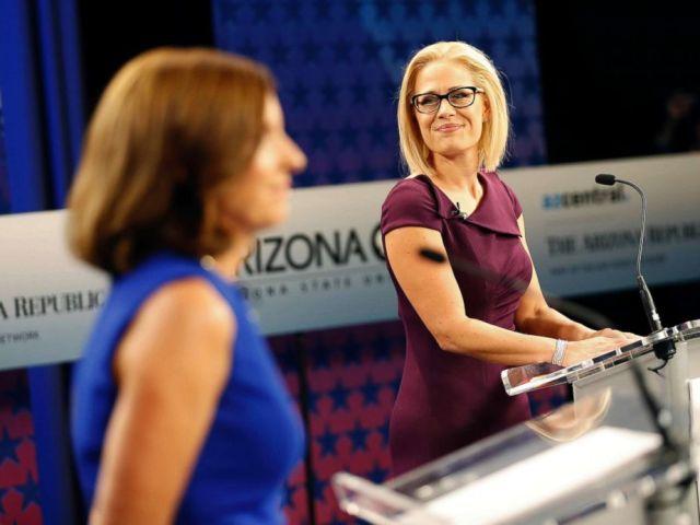 PHOTO: U.S. Senate candidates, Rep. Martha McSally and Rep. Kyrsten Sinema prepare their remarks prior to a televised debate, Oct. 15, 2018, in Phoenix.
