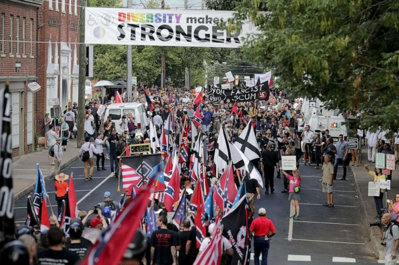 PHOTO: Hundreds of white nationalists, neo-Nazis and members of the alt-right march down East Market Street toward Emancipation Park during the Unite the Right rally August 12, 2017 in Charlottesville, Virginia.