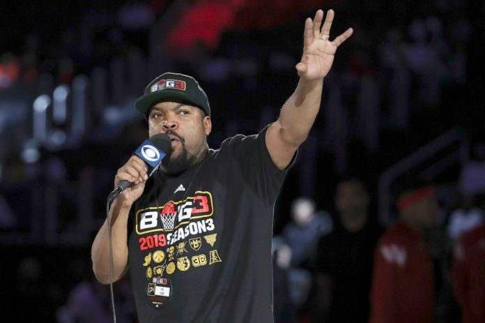 PHOTO:   Ice Cube speaks to the crowd before the basketball game between the 3 Headed Monsters and the Trilogy in Detroit, June 22, 2019.