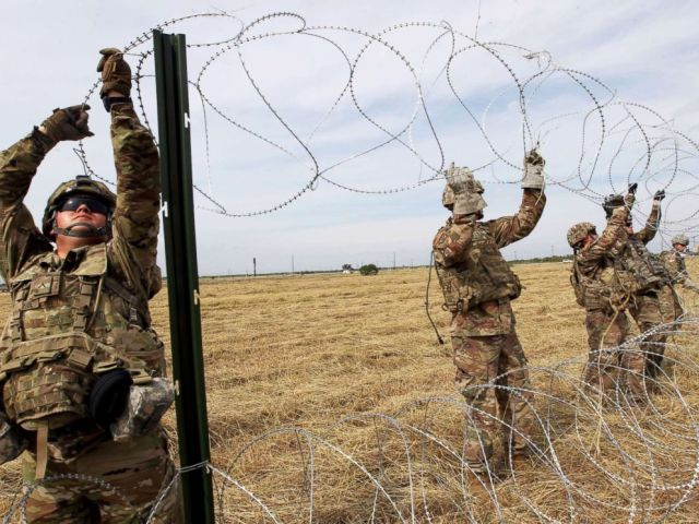 PHOTO: Army soldiers from Ft. Riley, Kansas, put up razor wire fence for an encampment to be used by the military near the U.S. Mexico border in Donna, Texas, Nov. 4, 2018.