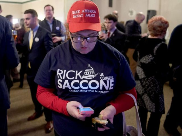 PHOTO: Campaign volunteer Chloe Chappell checks early election results at an Election Night event for GOP PA Congressional Candidate Rick Saccone as the polls close on March 13, 2018 in Elizabeth Township, Pennsylvania.