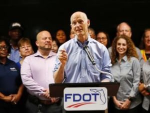 PHOTO: Florida Gov. Rick Scott, center, speaks during a news conference at the Florida Department of Transportation (FDOT) District Four Office, Aug. 22, 2018, in Fort Lauderdale, Fla.