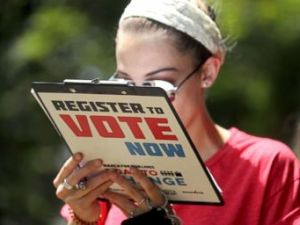 PHOTO: Chloe Weiland registers to vote during the Road to Change bus tour, July 28, 2018, in Tallahassee, Fla.
