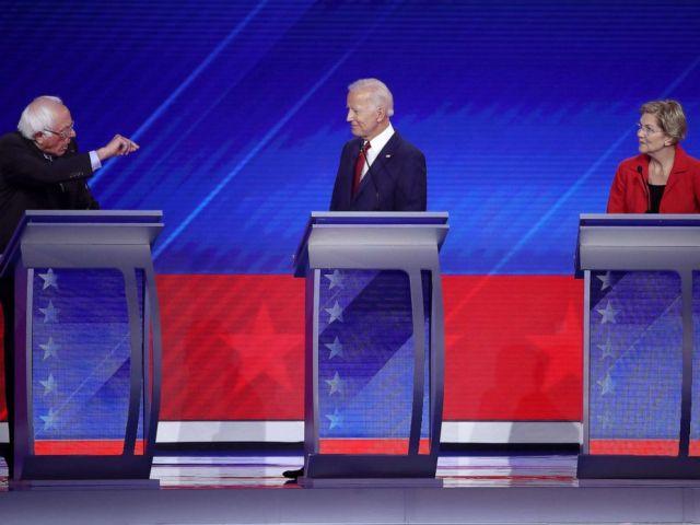 PHOTO: Democratic presidential candidates Sen. Bernie Sanders speaks as former Vice President Joe Biden and Sen. Elizabeth Warren listen during the Democratic Presidential Debate, Sept. 12, 2019 in Houston, Texas.