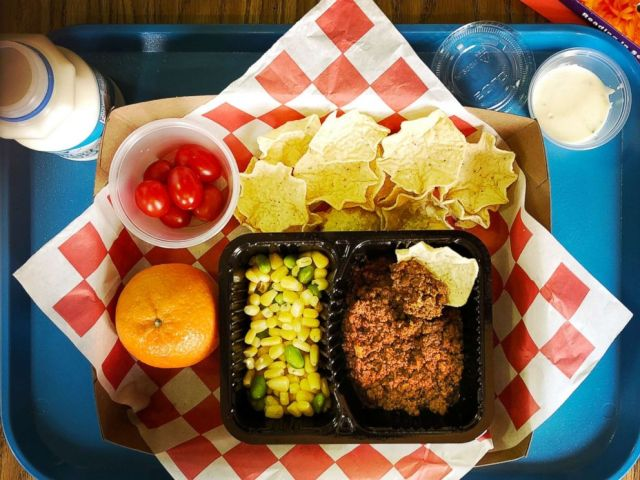 PHOTO: Homemade taco, tortilla chips, corn and edamame, grape tomatoes, ranch dressing, clementine & 1% milk make up a student meal at at an elementary school in Silver Spring, Md., Feb. 12, 2018.