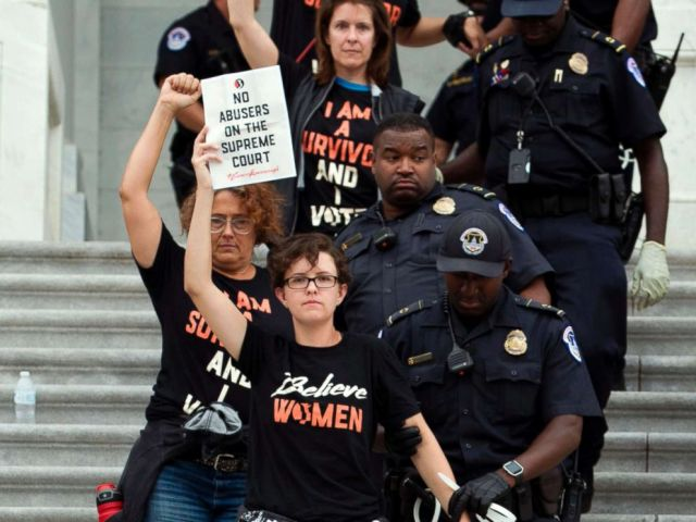 PHOTO: Demonstrators are arrested on the steps of the Capitol as they protest the appointment of Supreme Court nominee Brett Kavanaugh, Oct. 6, 2018.