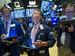 PHOTO: Traders and financial professionals work on the floor of the New York Stock Exchange (NYSE) at the opening bell on August 13, 2019, in New York.