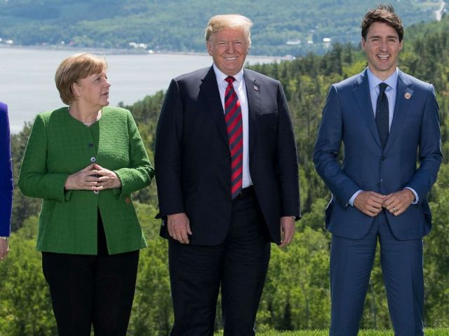PHOTO: British Prime Minister Theresa May, German Chancellor Angela Merkel, US President Donald Trump, and Canadian Prime Minister Justin Trudeau pose for a family photo during the G7 Summit in in La Malbaie, Quebec, Canada, June 8, 2018.