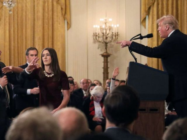 PHOTO: A White House staff member reaches for the microphone held by CNNs Jim Acosta as he questions President Donald Trump during a news conference following Tuesdays midterm elections at the White House in Washington, Nov. 7, 2018.