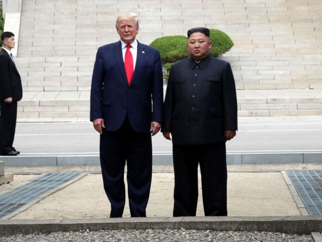 PHOTO: A handout photo provided by Dong-A Ilbo of North Korean leader Kim Jong Un and U.S. President Donald Trump inside the demilitarized zone (DMZ) separating the South and North Korea on June 30, 2019 in Panmunjom, South Korea.