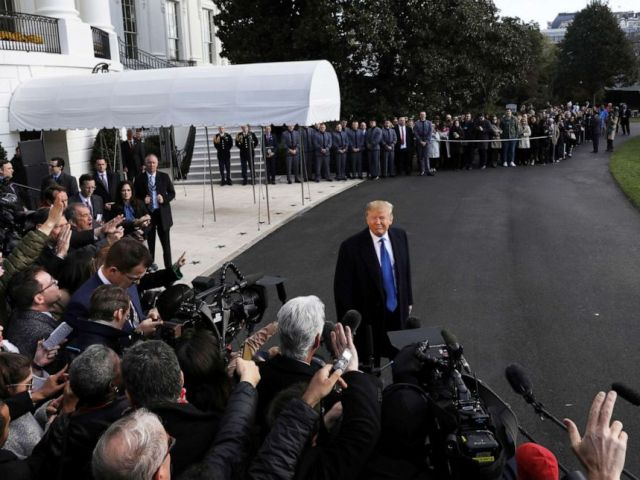 PHOTO: President Donald Trump speaks to the news media before boarding Marine One to depart for travel to Georgia from the South Lawn of the White House in Washington, D.C., Nov. 8, 2019.
