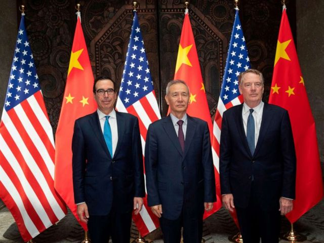 PHOTO: Chinese Vice Premier Liu He (C) with United States Trade Representative Robert Lighthizer (R) and Treasury Secretary Steven Mnuchin (L) pose for photos before holding talks at the Xijiao Conference Center in Shanghai, July 31, 2019.