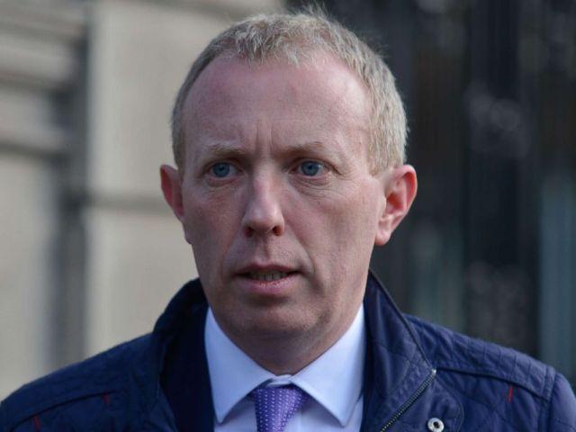 PHOTO: Fianna Fails Timmy Dooley, leaves the Leinster House in Dublin, seat of Dail Eireann, April 14, 2016.