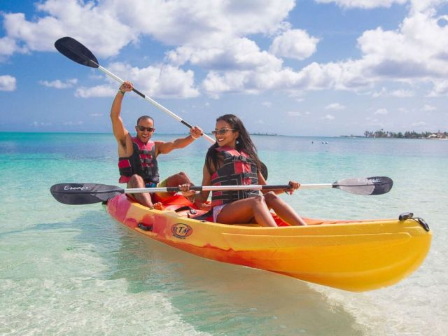 PHOTO: A man and woman use a kayak in a promotional photo for Breezes Resort & Spa in the Bahamas.