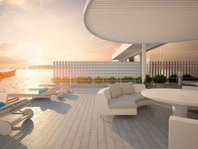 Murakas upper level features bedrooms, a living room, kitchen, bar and dining room, and a deck.