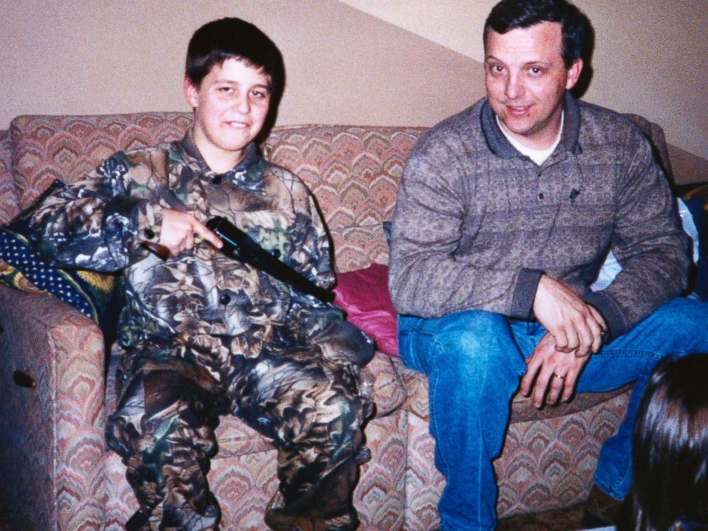 PHOTO: In a family photo, Andrew Golden holds a handgun as he sits in the living room with his father. Andrew is one of two boys accused in the shooting deaths of four girls and one teacher at the Westside Middle School, March 24, 1998.