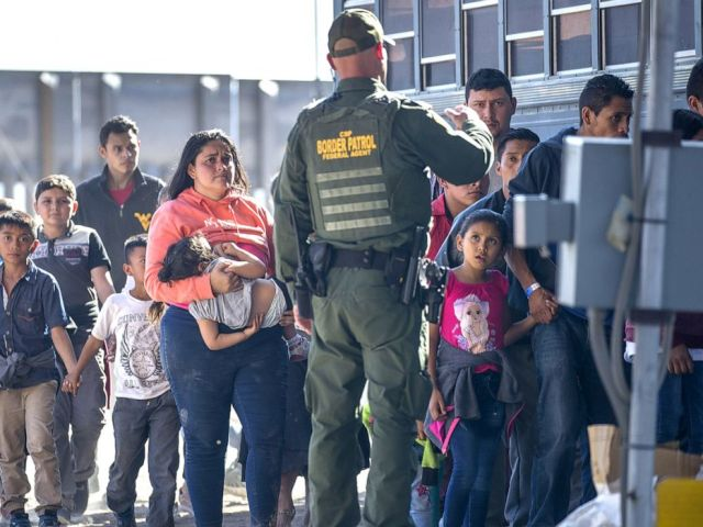 PHOTO: Detained migrants are loaded onto a bus by Border Patrol agents after crossing into the United States from Mexico, June 1, 2019, in El Paso, Texas.