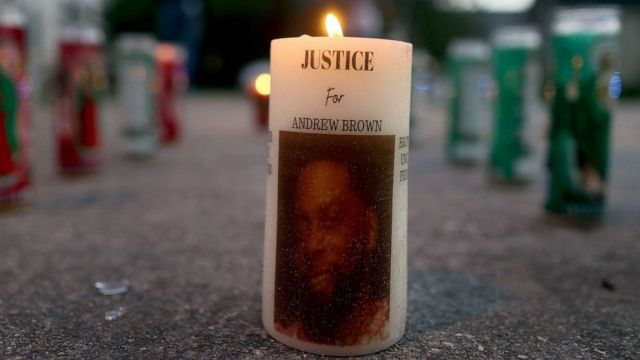 PHOTO: A lite candle in a memorial built to honor Andrew Brown Jr, May 1, 2021, in Elizabeth City, North Carolina.