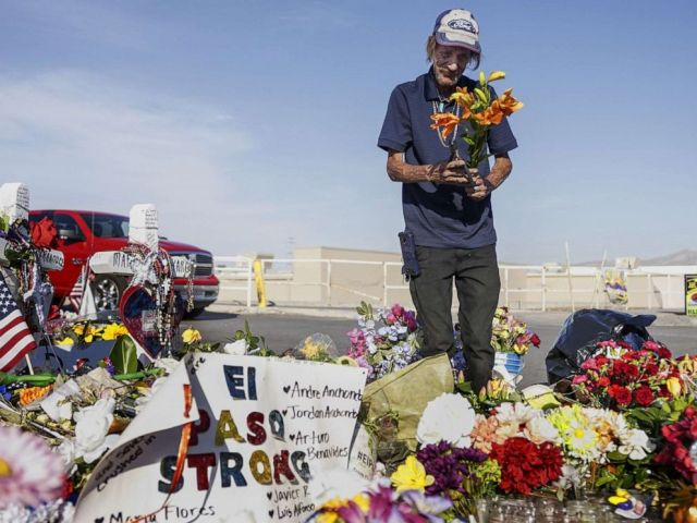 PHOTO: Antonio Basco, whos wife Margie Reckard was one of 22 persons killed by a gunman at a local Walmart, lays flowers in her honor at a makeshift memorial near the scene on August 16, 2019 in El Paso, Texas.