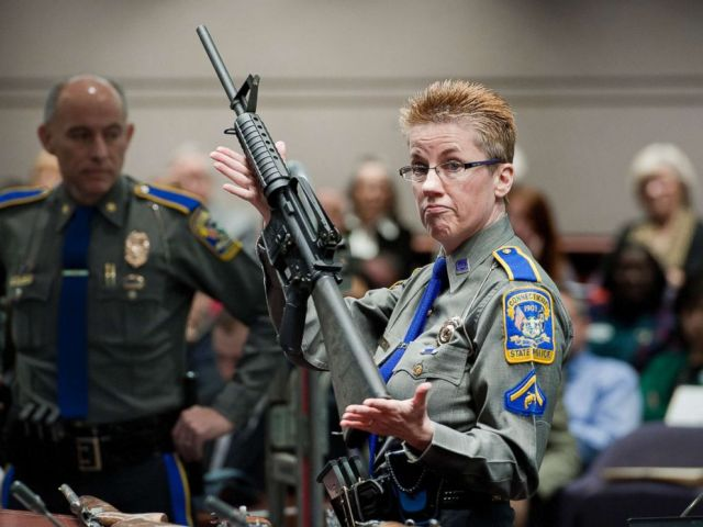 PHOTO: A Connecticut State Police officer holds up a Bushmaster AR-15-style rifle, the same make and model of gun used by Adam Lanza in the Sandy Hook School shooting at the Legislative Office Building in Hartford, Conn., Jan. 28, 2013.