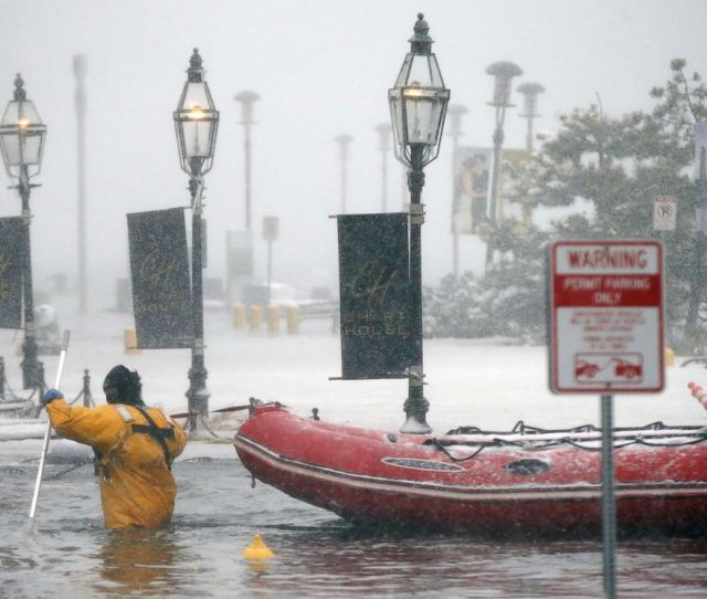 Photo A Firefighter Wades Through Flood Waters From Boston Harbor On Long Wharf In Boston