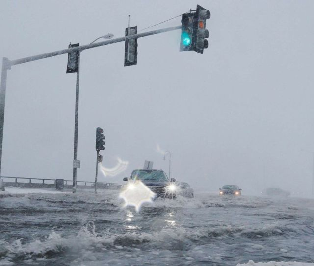 Snowstorm Floods Boston Harbor And Coastal Massachusetts Streets With Icy Water