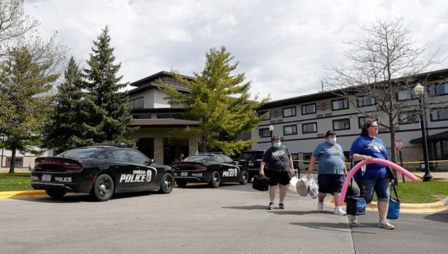 PHOTO: Guests leave the Oneida Casino/Radisson Hotel & Conference Center on Sunday morning, May 2, 2021, after a shooting took place on Saturday where three people were killed, including the gunman, and one person was seriously injured.