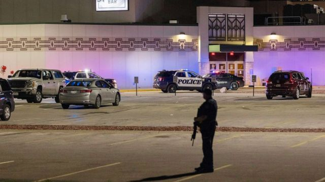 PHOTO: Police stand guard in the parking area outside the Oneida Casino in the early morning hours, May 2, 2021, near Green Bay, Wis., following a shooting that left three dead and seriously wounded another.