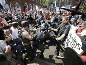 PHOTO: White nationalists, neo-Nazis and members of the extreme right clash with counter-protesters as they enter Lee Park during a rally on Aug. 12, 2017 in Charlottesville, Va.