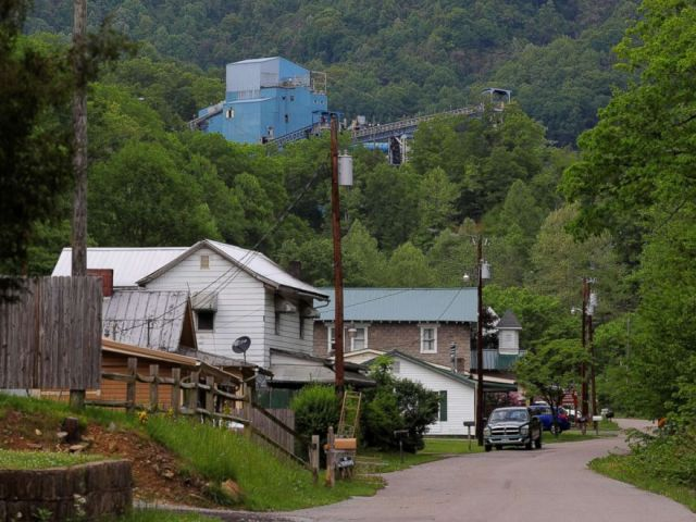 PHOTO: Coal camp company houses sit below the Lone Mountain Processing coal mine in St. Charles, Va., May 18, 2018.