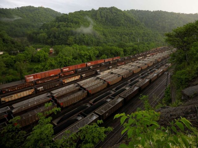PHOTO: Train cars filled with coal wait on the tracks outside Williamson, W.Va., May 17, 2018.