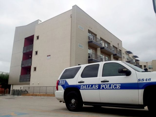 PHOTO: A Dallas Police vehicle is parked near the South Side Flats apartments in Dallas, Sept. 10, 2018.