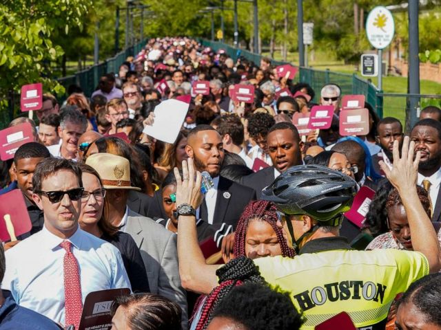 PHOTO: People wait to go through security before entering the Democratic presidential debate inside Texas Southern Universitys Health & PE Arena in Houston, Thursday, Sept. 12, 2019.