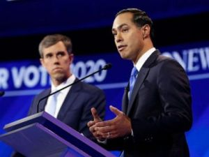 PHOTO: Beto ORourke watches while Julian Castro speaks during the third Democratic Primary Debate, in Houston, Sept. 12, 2019.