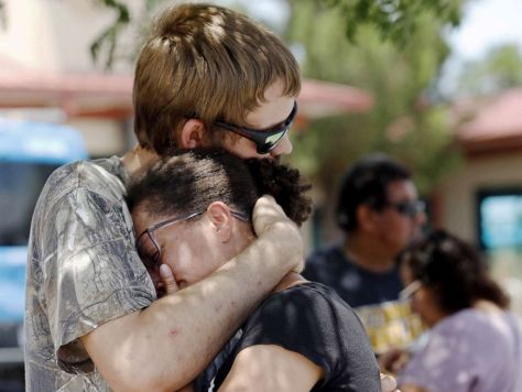 PHOTO:A man comforts a woman who was in the freezer section of a Walmart during a shooting incident, in El Paso, Texas, Aug. 03, 2019.