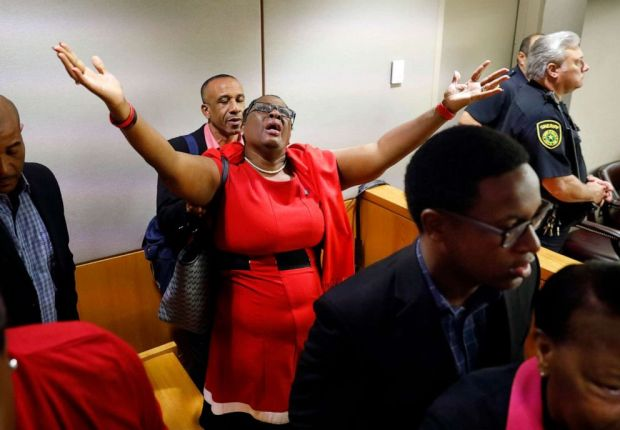 PHOTO: Botham Jeans mother, Allison Jean, rejoices in the courtroom after fired Dallas police Officer Amber Guyger was found guilty of murder, Oct. 1, 2019, in Dallas.
